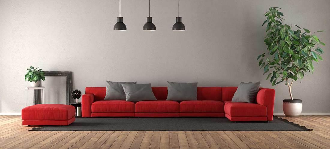 Modern living room with red corner sofa on black carpet
