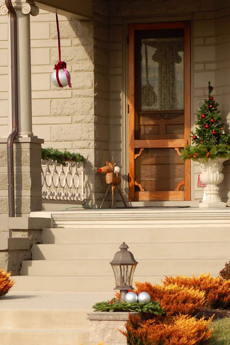 Porch with Christmas tree by the door step