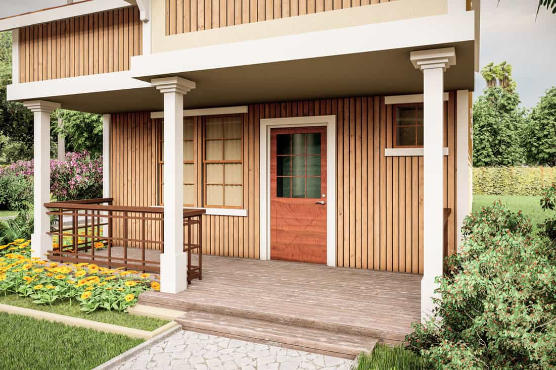 Rustic themed front porch with brown doors and wooden cladding