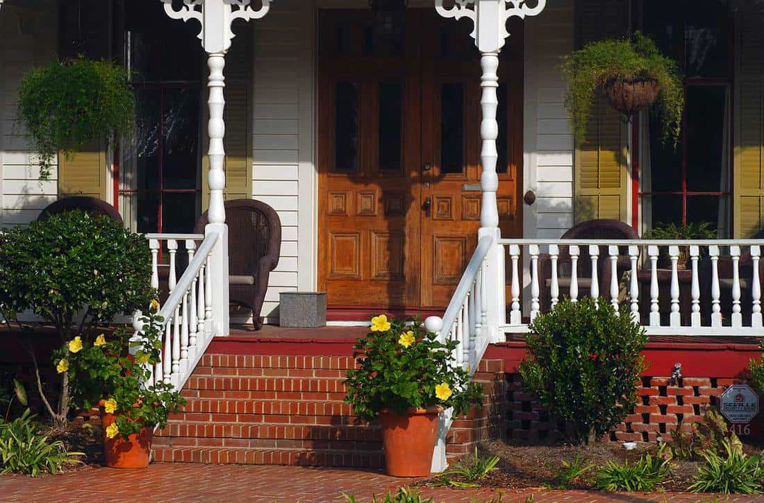 Southern porch with double doors and stairway to entrance
