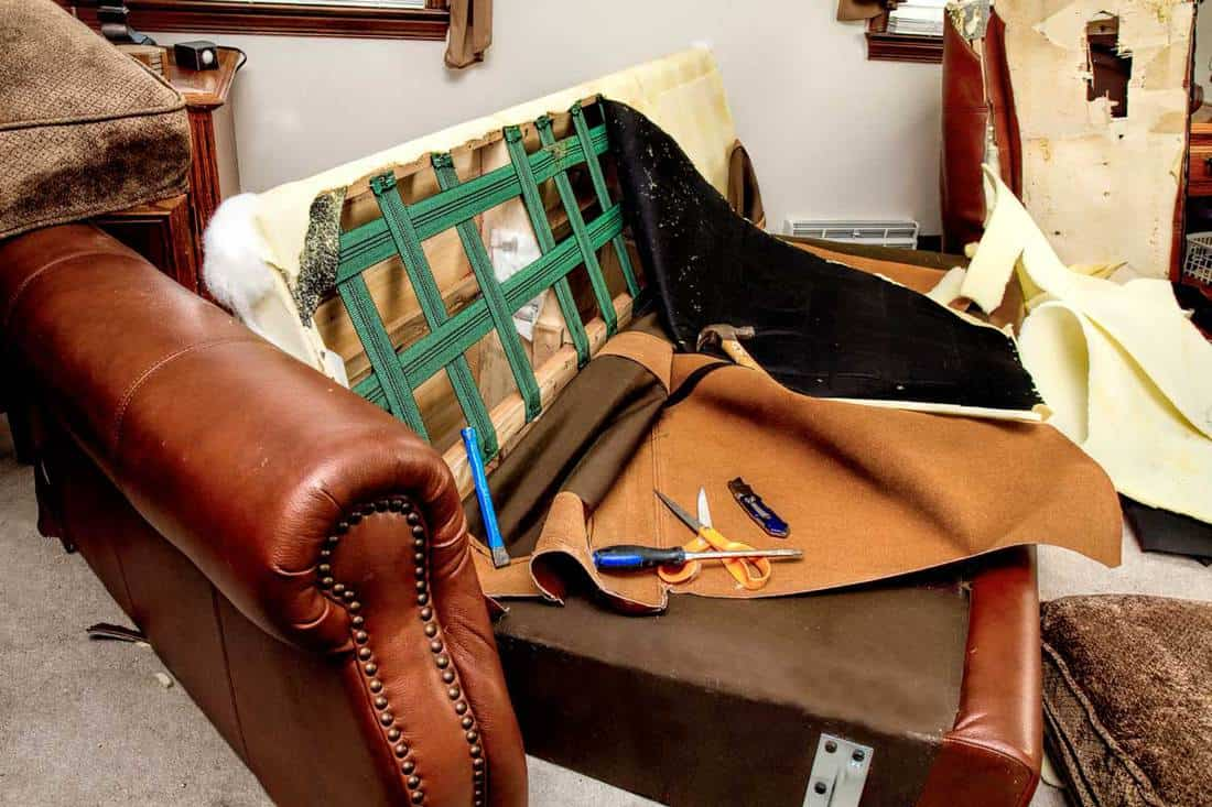 Upholstery Dismantling - Sofa being ripped apart and frame showing underneath the materials, How Much Does it Cost to Replace Sofa Cushions?