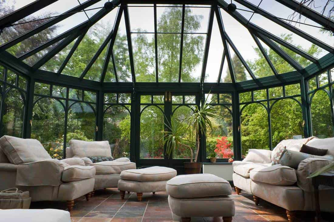 Very ambient living entertainment room with glass walls and glass roofing