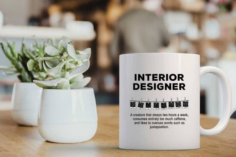 White interior designer coffee mug on a wooden table, 11 Mugs For Interior Designers [Gift Ideas Guide]