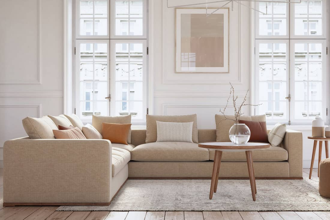 White walled living room with brown sofa near window