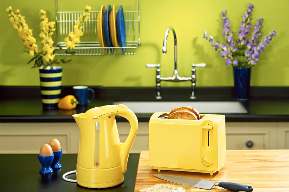 Yellow walled kitchen with yellow and blue utensils