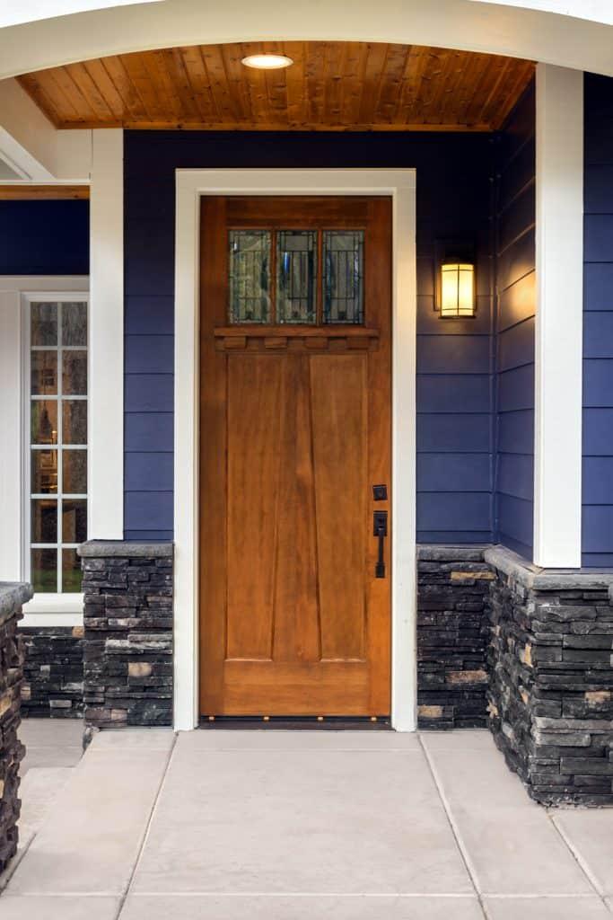 Brown door blue house