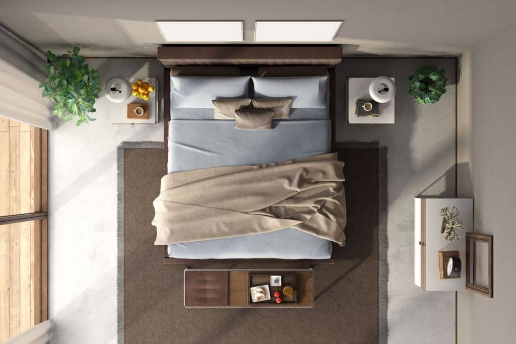 A bedroom on top view with a tanned colored wall and a messy bed