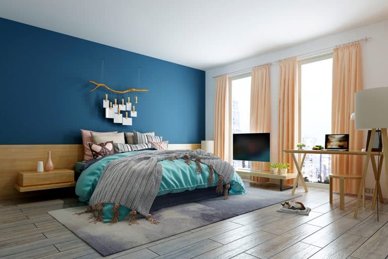 A bedroom with a blue and white colored wall and a peach colored curtain mixed with a sky blue bedding set, How To Choose Curtains For The Bedroom