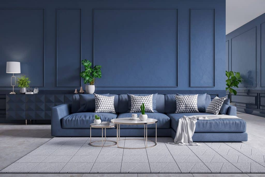 A blue colored living room with blue hallway with blue couch