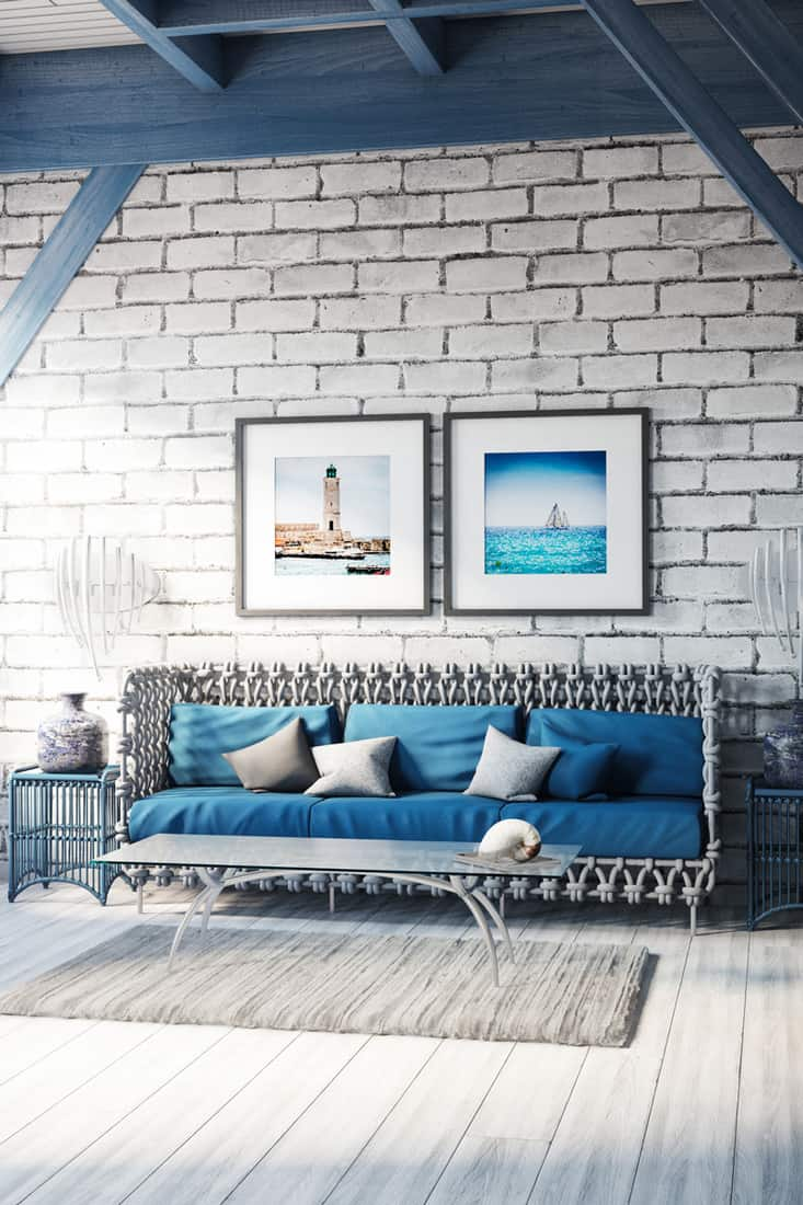 A blue themed living room with a blue couch and blue trusses and columns