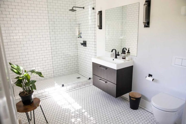A bright and airy luxury white small bathroom, What Colors Make a Small Bathroom Look Bigger?