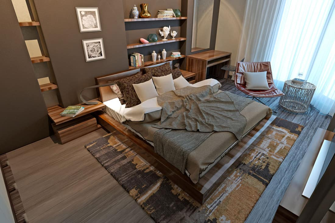 A brown themed bedroom with a gray bed and white curtains