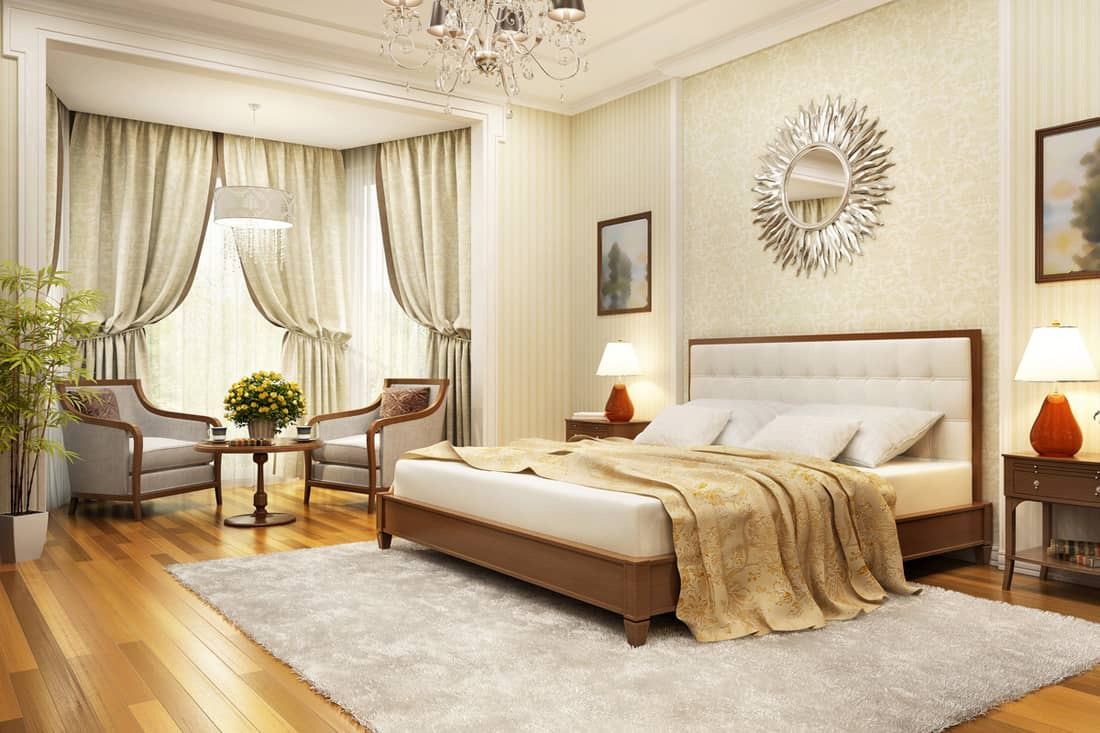 A classic style bedroom with beige colored walls and white curtains
