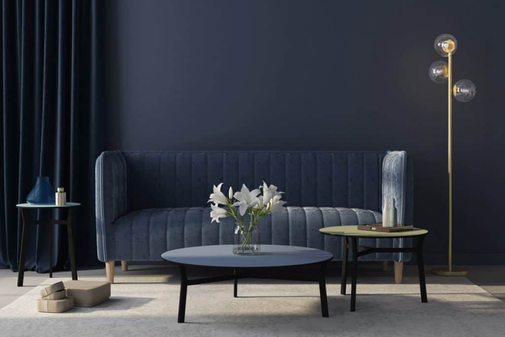 A dark blue themed living room with a dirty white colored flooring