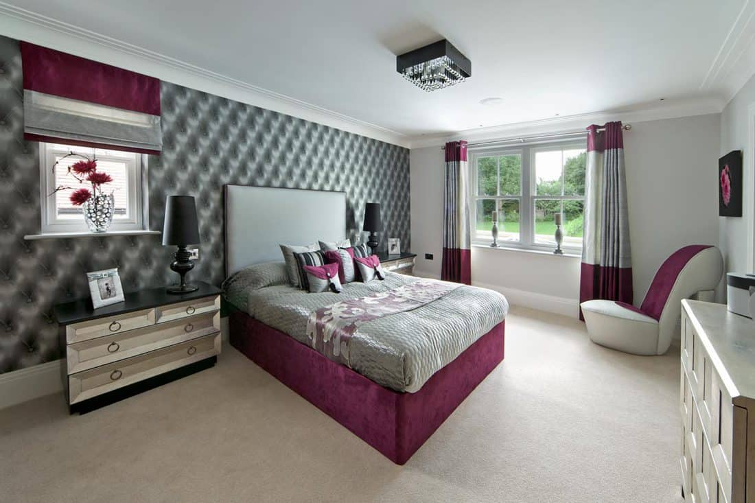 A gray bedroom with a combination of violet for aesthetics of the whole bedroom