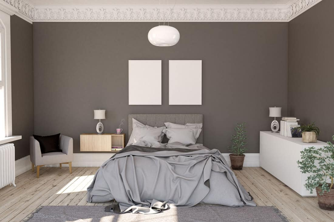 A gray bedroom with a gray bed