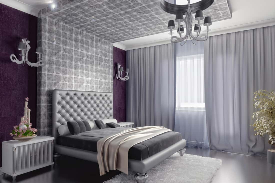 A gray colored living room with gray curtains and a gray tiled headboard