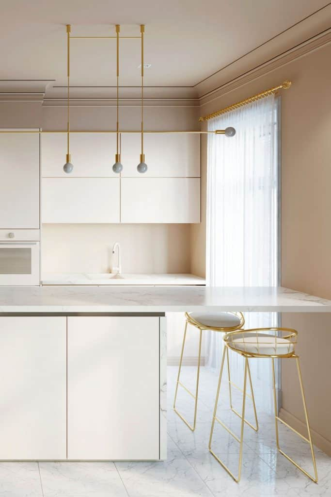 A kitchen with a white curtain and a tan wall