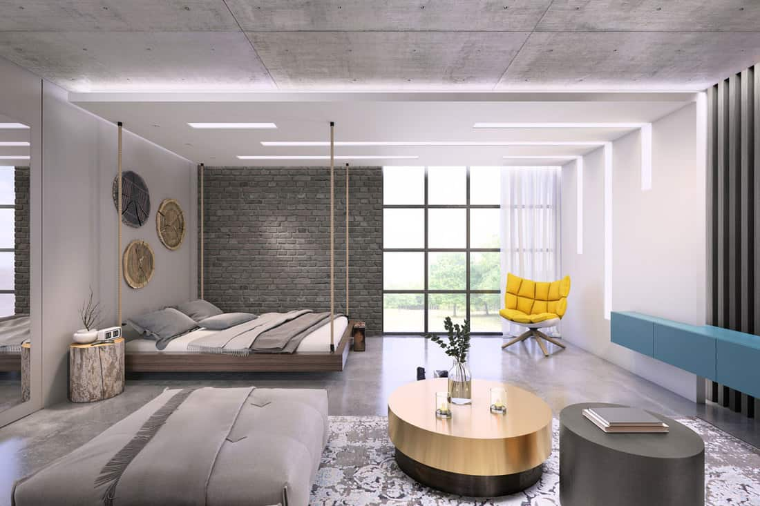 A modern gray themed bedroom with a white bed and a huge window