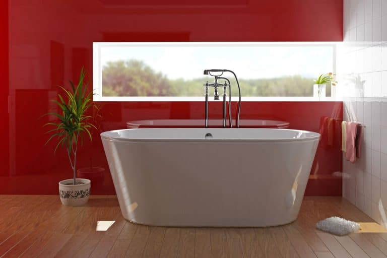 A red colored bathroom with a modern bathtub and a wooden flooring, How To Install A Bathtub Liner [6 Steps]