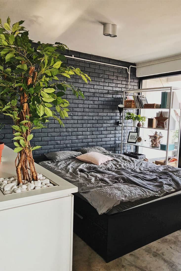 A rustic themed bedroom with gray bedding sets