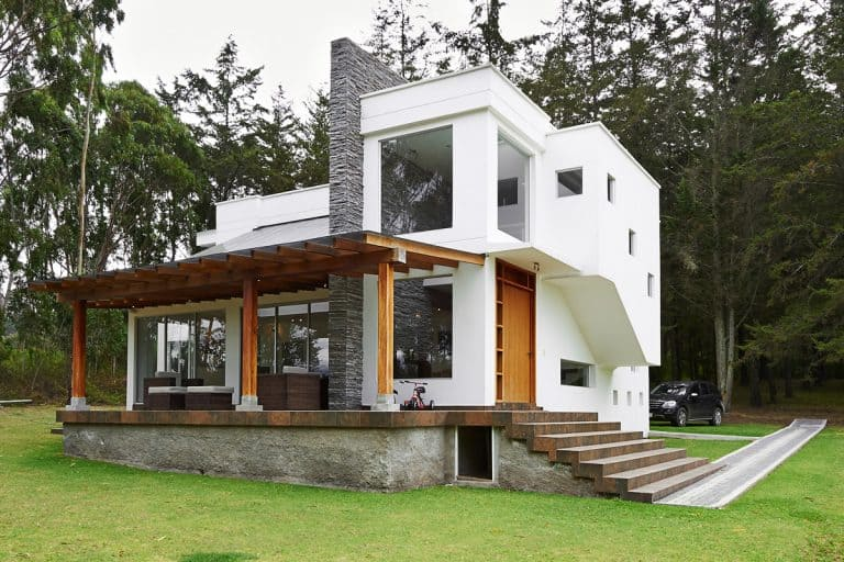 A two storey modern contemporary house with white painted walls and a brown front door, Front Door Color For A White House [Inc. 20 Photo Ideas]