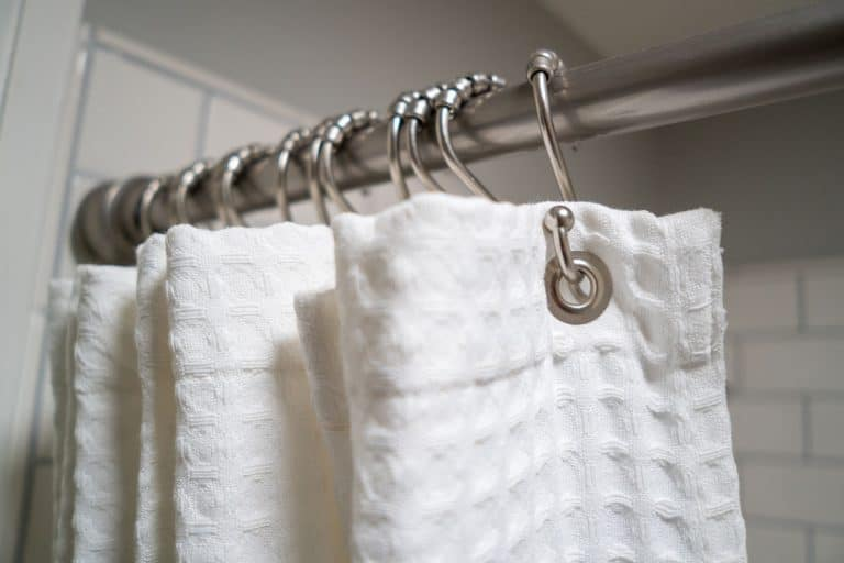 A white shower curtain with stainless steel curtain, How To Wash A Shower Curtain or Shower Curtain Liner