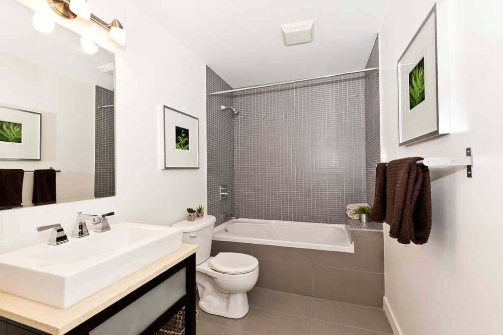 Bathroom interior with gray tiles and white walls