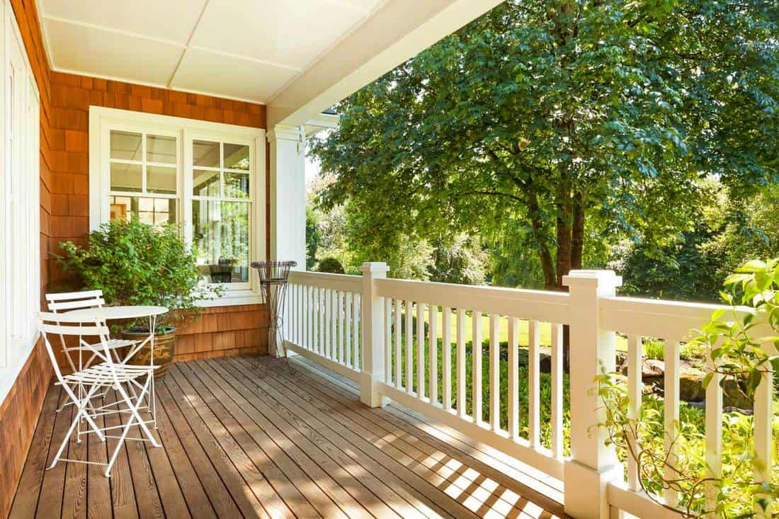 Beautiful front porch with table and chairs, on a lovely summer day, What Is A Good Size For A Front Porch?