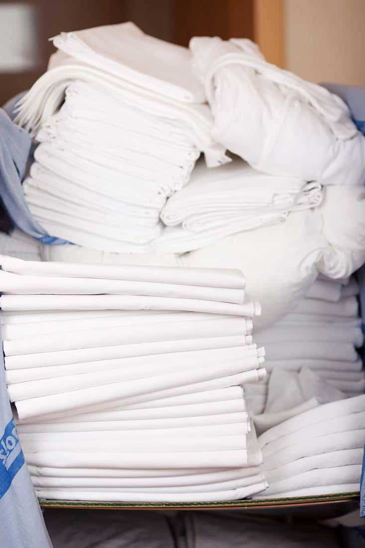 Bedsheets stacked in stock room