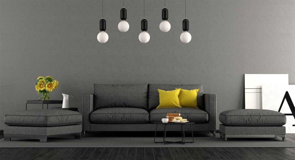 Black and grey living room with sofa and footstools