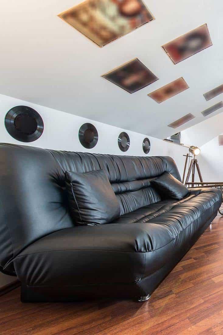 Black leather sofa in loft apartment