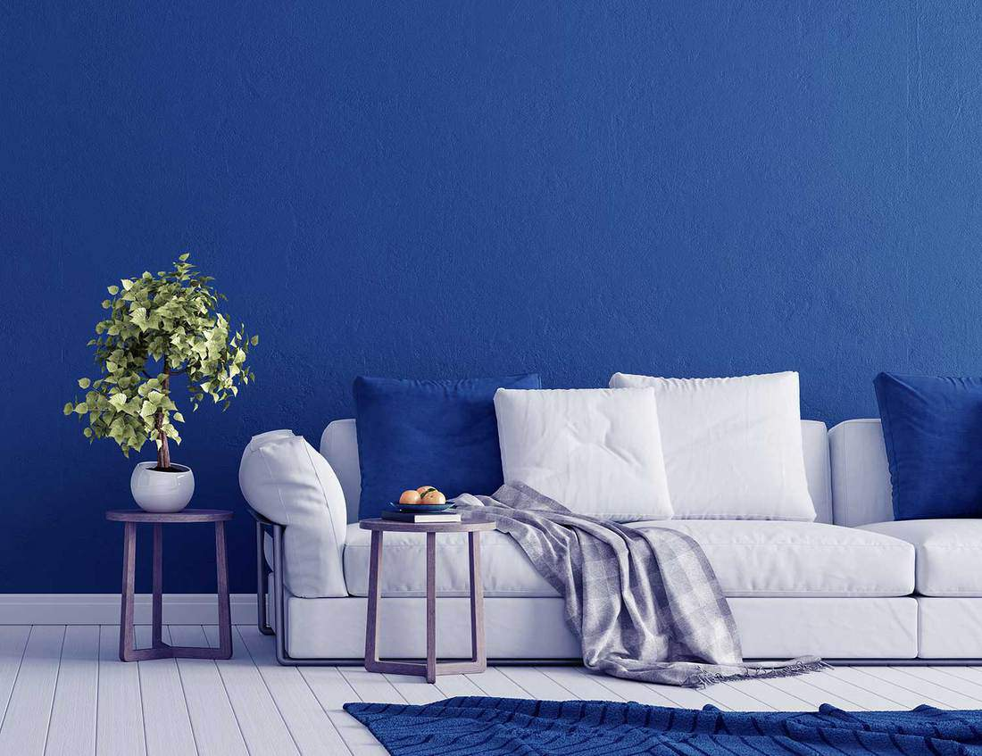 Blue concrete wall with white modern furniture in minimal interior design living room