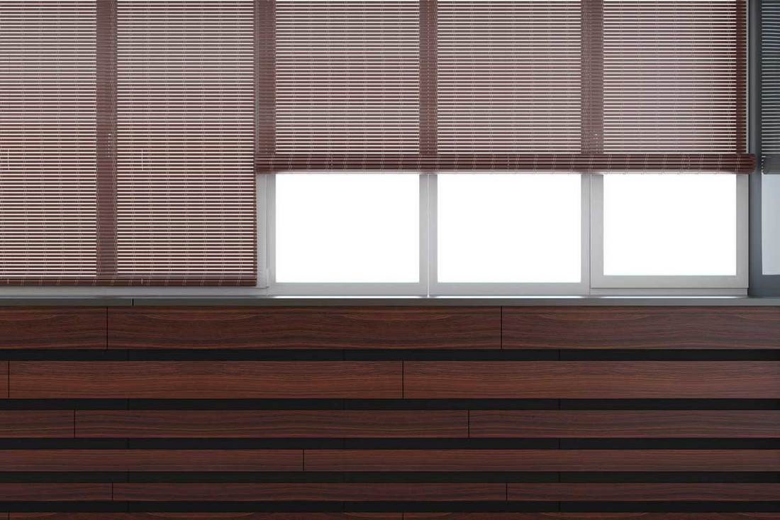 brown colored blinds roll on the windows