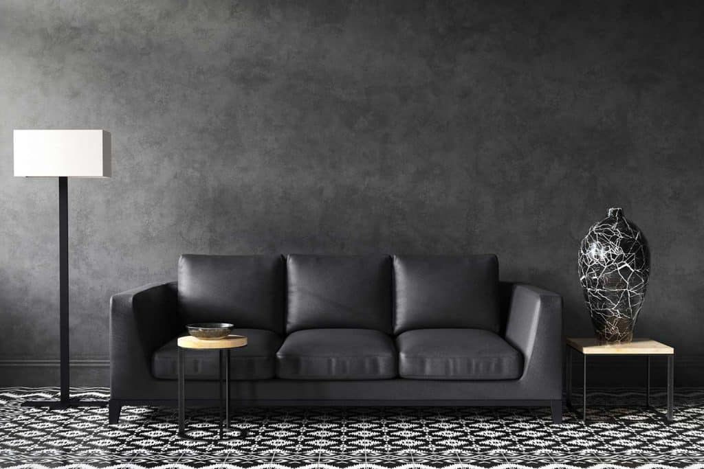 Dark gray sofa and decor in stylish loft living room interior