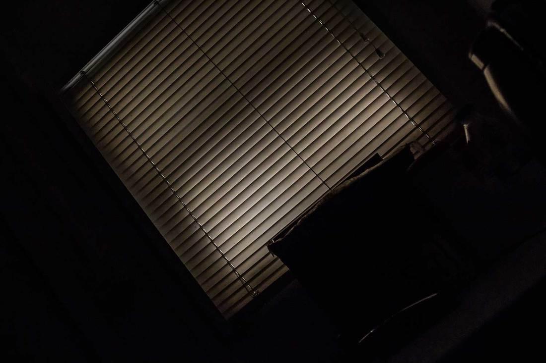 Dark room with jalousie window