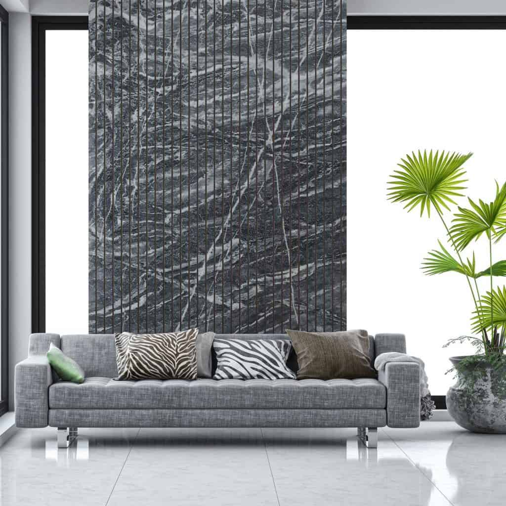 Elegant living room with grey sofa on light grey marble tiled floor in front of grey marbled wall