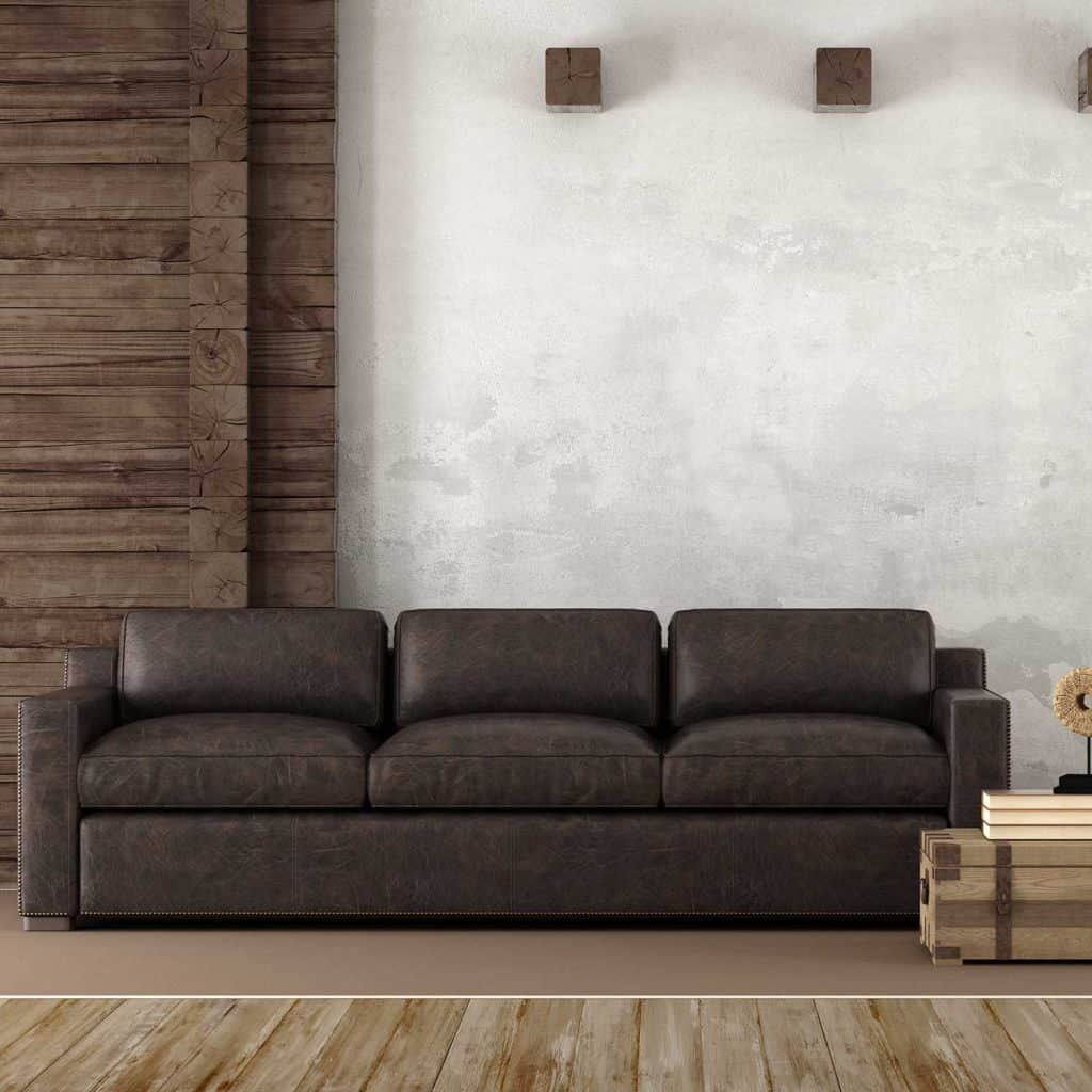 Home interior in rustic style with leather couch and old wooden paneling