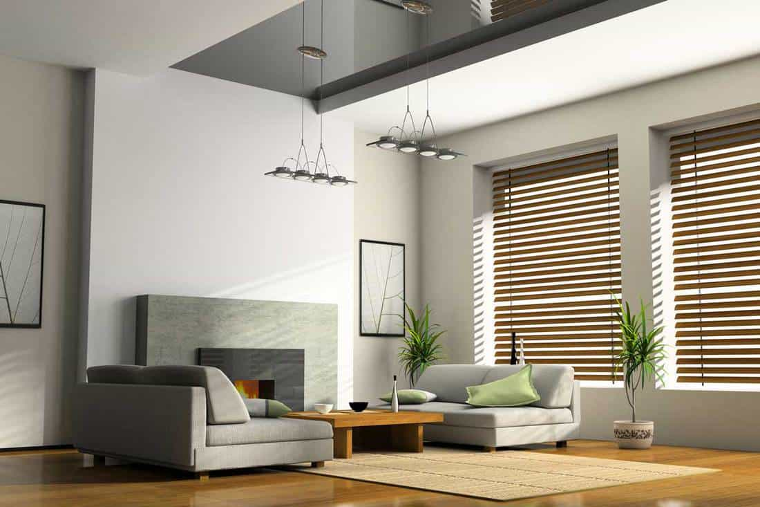 Home interior with fireplace and sofas with brown colored blinds
