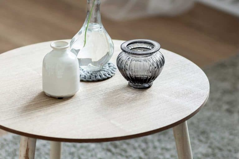 Home interior with scandinavian style wooden round coffee table, What To Put On A Coffee Table [6 GREAT Suggestions]