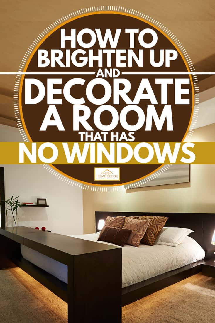 A modern bedroom with a table in front of the bed and a mirror on the side, How To Brighten Up And Decorate A Room That Has No Windows
