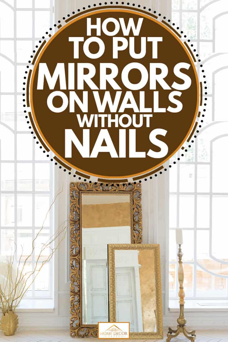 A white empty room with a classy mirror placed next to a wall, How To Put Mirrors On Walls Without Nails