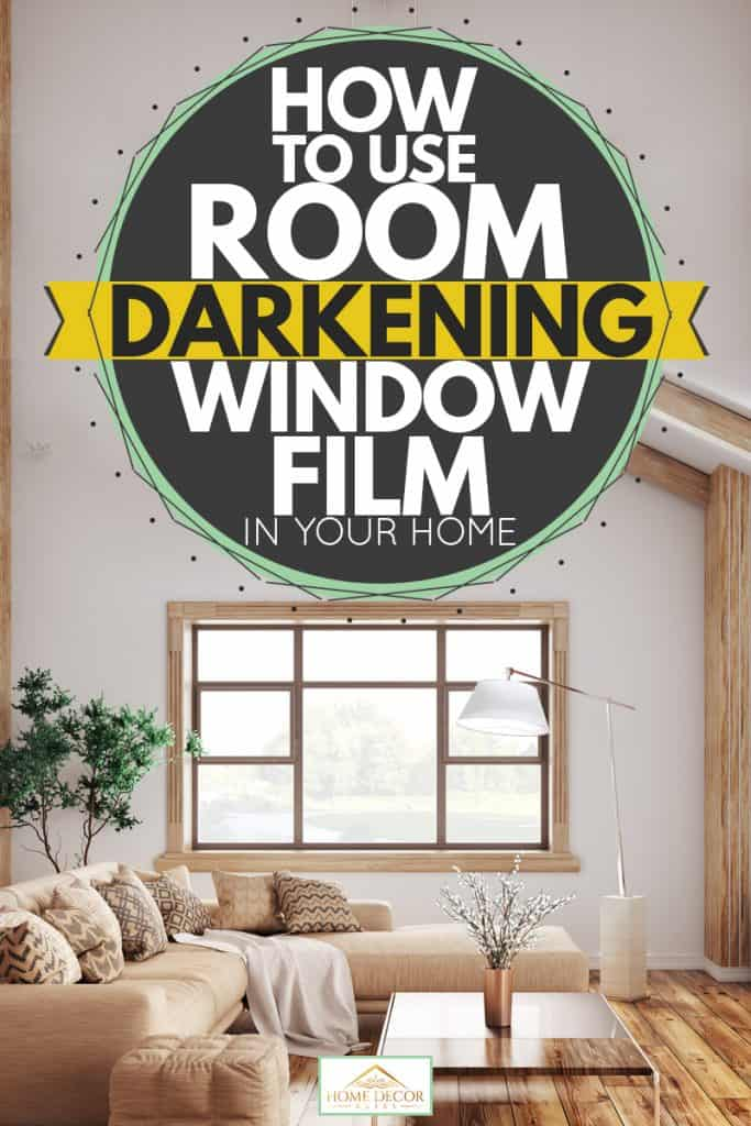 A modern living room with a white colored wall, exposed wooden trusses, and an indoor plant on the side, How to Use Room darkening window film in your home