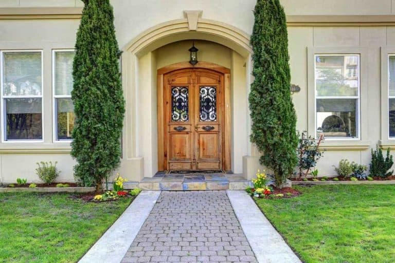 Luxury house entrance porch with walkway and arched wooden front door, Arched Front Door Ideas [Inc. 23 Pictures]