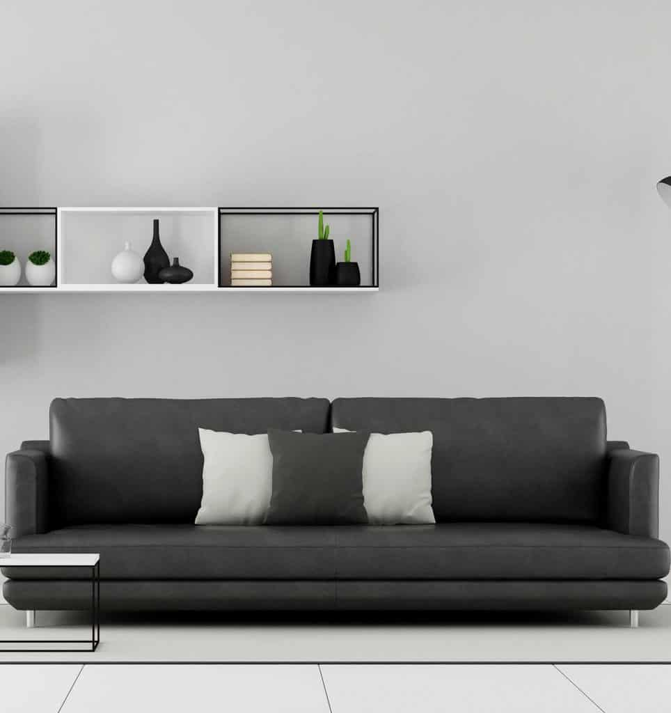 Minimalist living room with black sofa and sideboard on wall