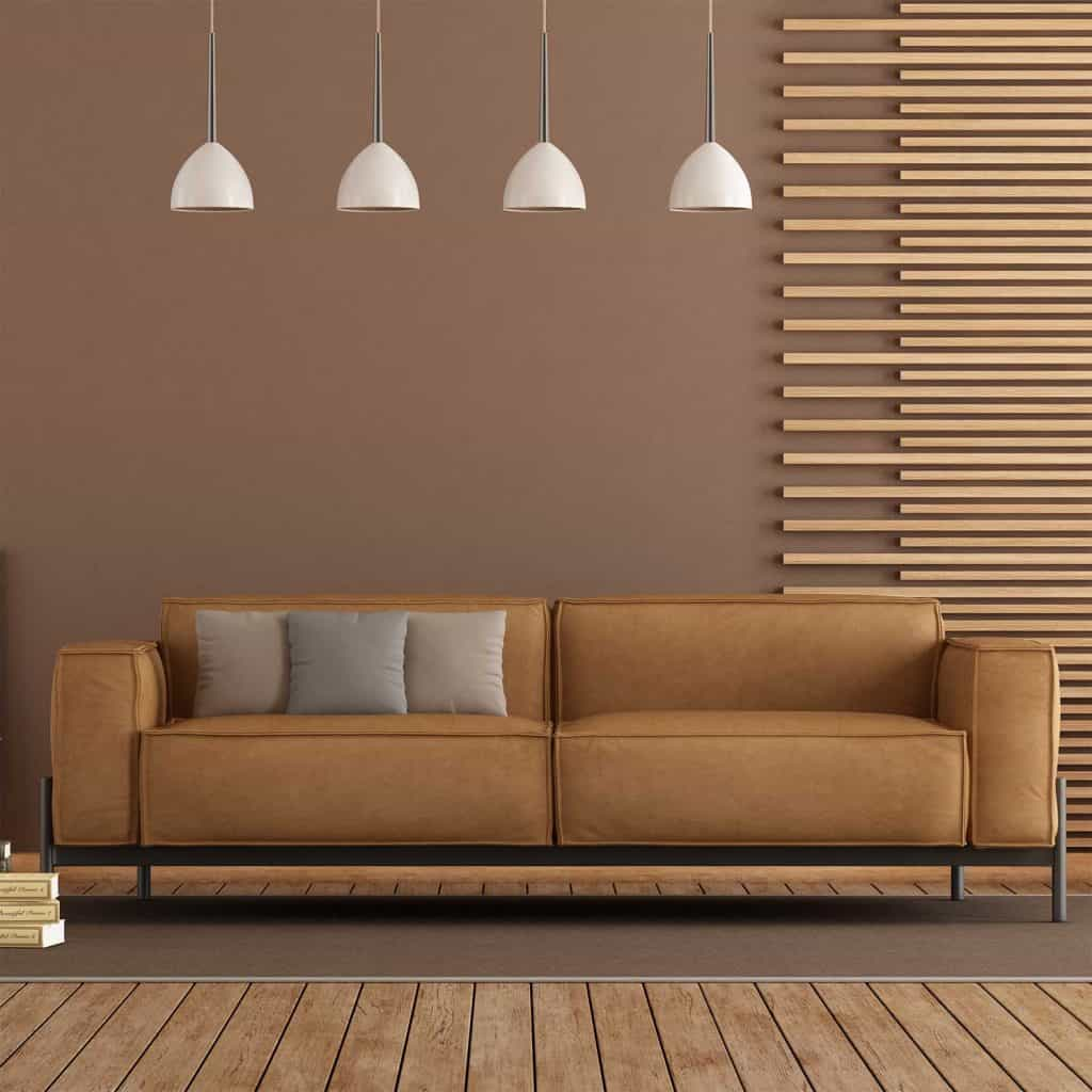 Modern Living room with brown leather sofa, wooden paneling and brown wall