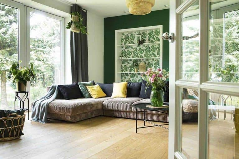 Modern and cozy living room with corduroy sofa pillows big window to the garden, What Curtains Go With Green Walls