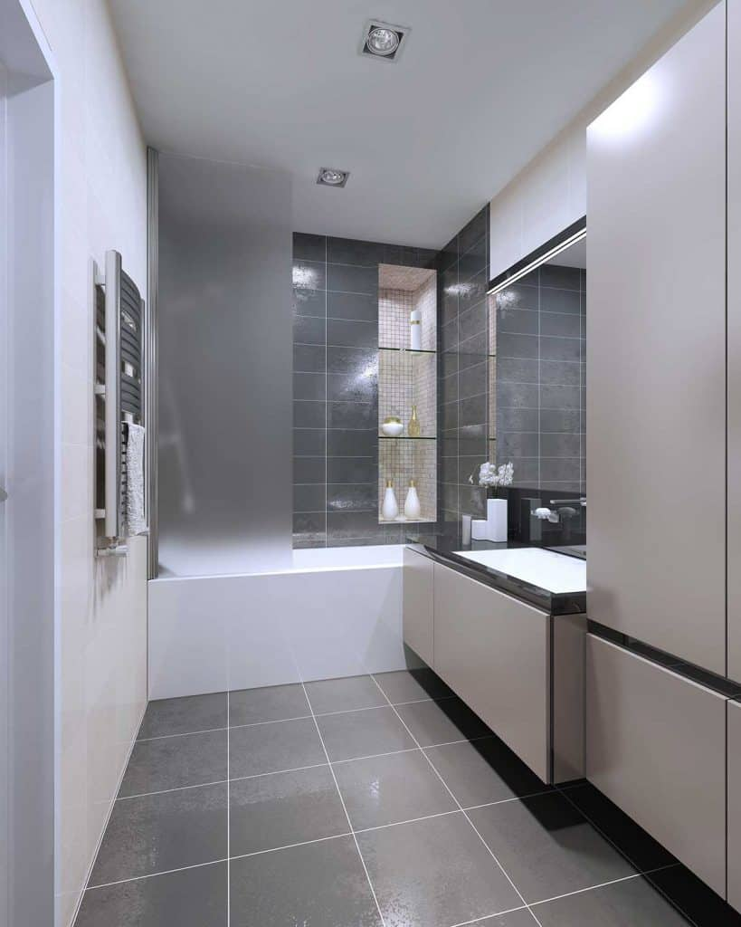 Modern bathroom design with gray tile floor and white tile walls