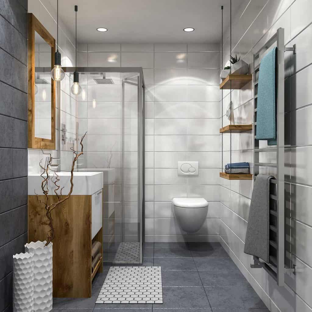 Modern bathroom interior with white tiles on wall and gray tiles on floor