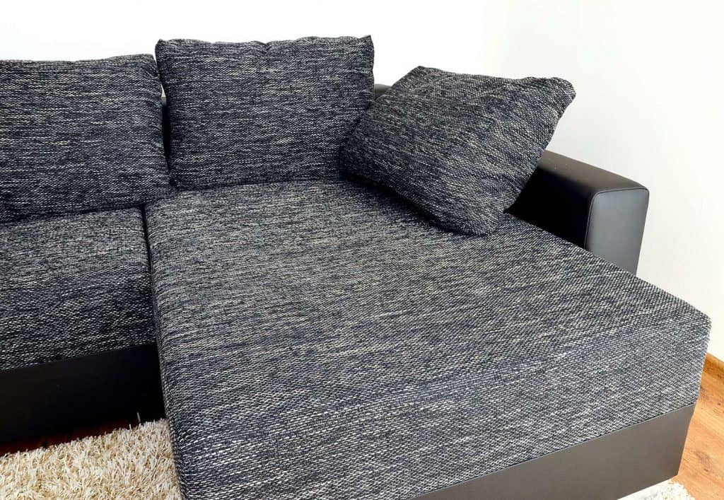Modern black and white cloth sofa with matching throw pillows